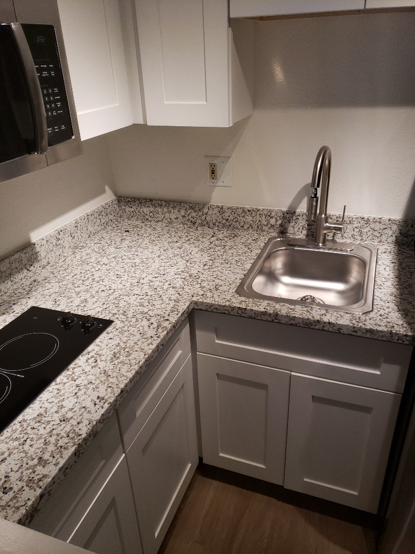 Walnut Creek, CA - Granite tops and cabinets in 2 rooms.