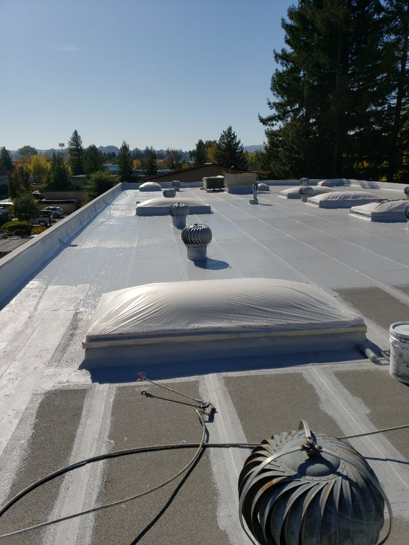 Cotati, CA - Roof corners and seams polyester and laying base glue and tac glue