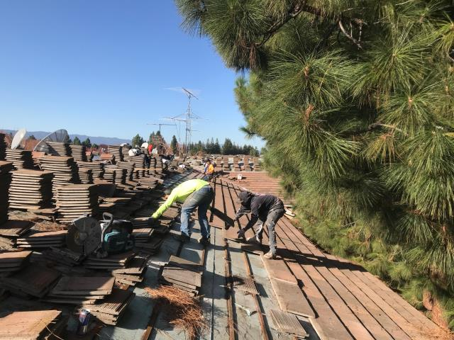 San Jose, CA - Our commercial roofing team is hard at work removing old tiles and underlayment and installing new peel and stick underlayment to reinstall new tiles on this roof near Blossom River Way, in San Jose, CA.