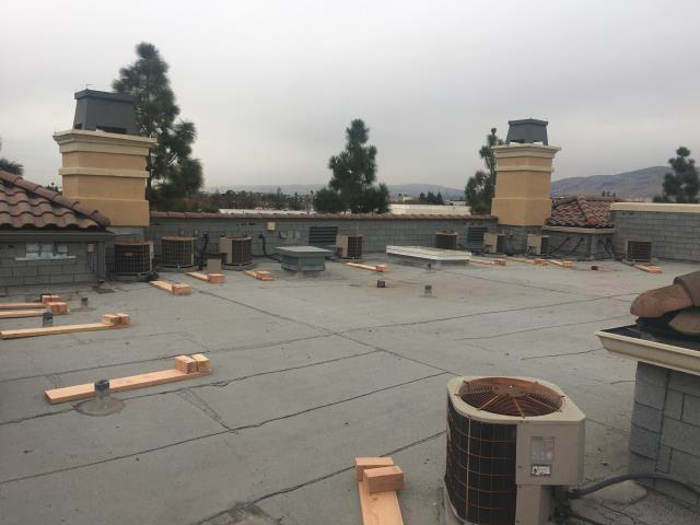 San Jose, CA - Our commercial roofing team here at Allied Construction Services has been prepping for an acrylic coating by raising all of the AC units on temporary stands while they wash down the roof and seal and penetrations before they bein the coating process.