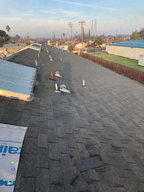 Stockton, CA - Our commercial roofing team here at Allied Construction Services had to demo the existing shingles on this roof and install new synthetic underlayment with new pipe jacks and former vents in addition to installing new title 24 shingles on this roof near Lever Blvd, in Stockton, CA.