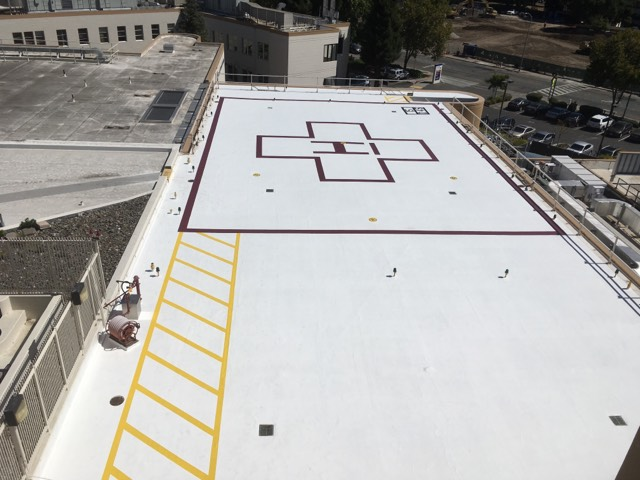 Santa Rosa, CA - Our commercial roofing team here at Allied Construction Services removed existing coating at Heli Pad.  Resurfaced and coated entire surfaceApplied the Markings to the surface.