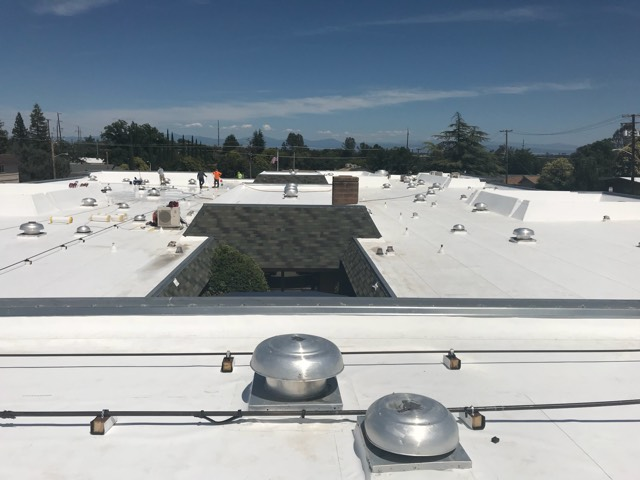 Redding, CA - Our commercial roofing team here at Allied Construction Services demo'd old built up roof,replaced dry rot as needed, andinstalled new TPO roofing