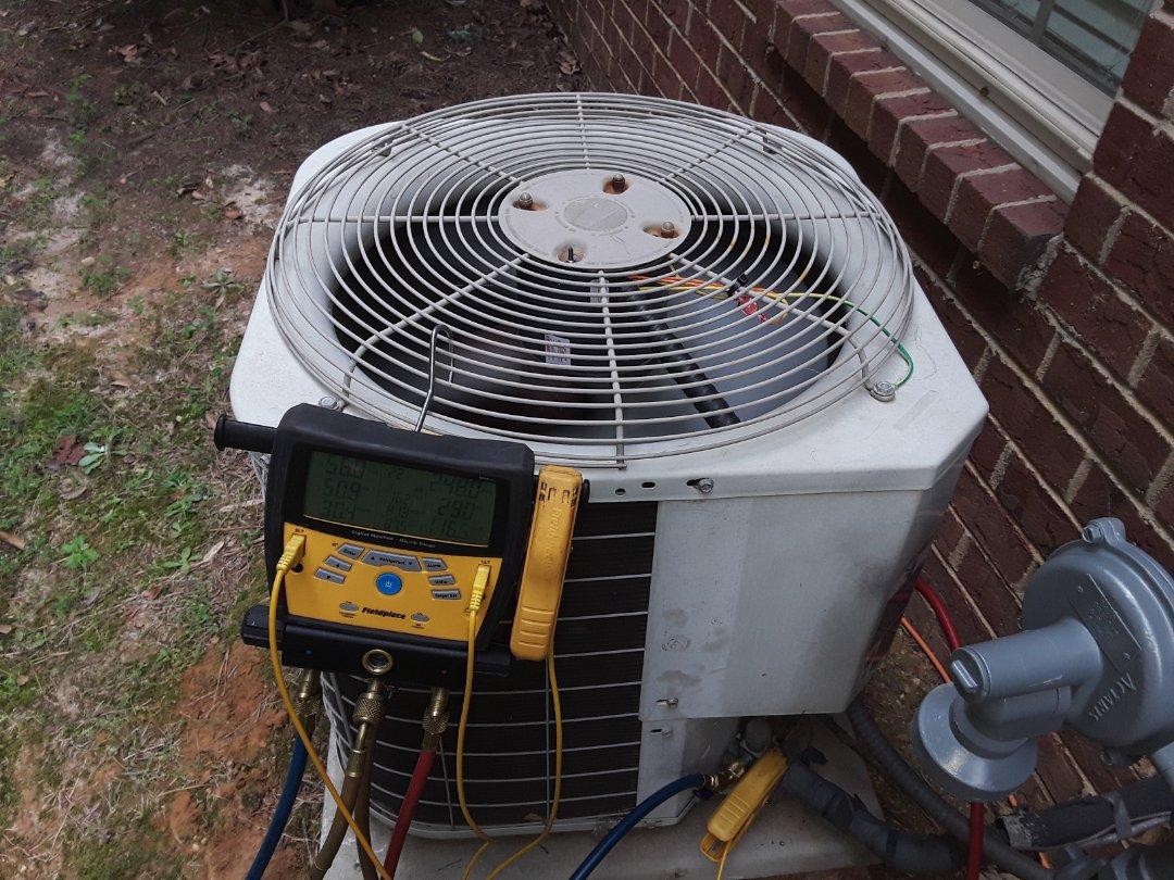Powder Springs, GA - Performed AC Maintenance on a Carrier condensing unit.  Powder springs