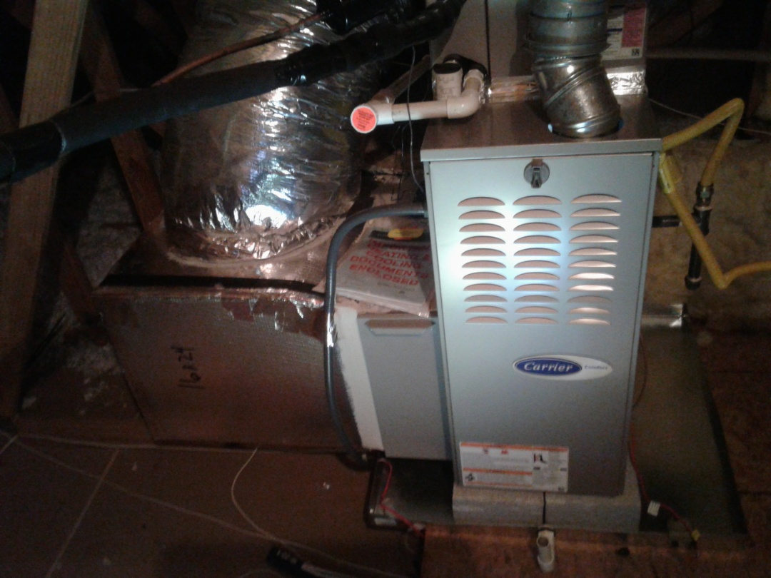 Acworth, GA - Performed Heat Maintenance on a Carrier Furnace. Acworth