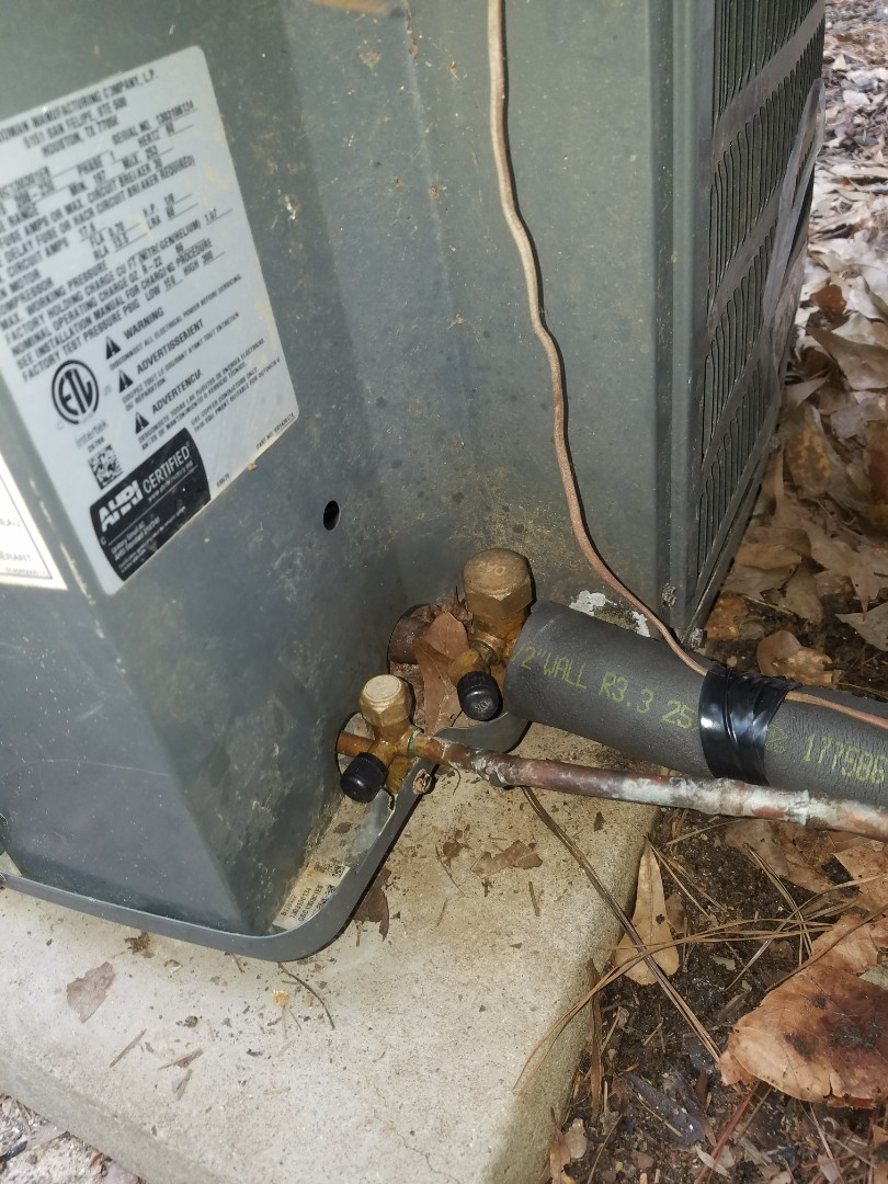 Kennesaw, GA - AC repair, repaired leaking refrigerant line at AC and recharged with appropriate amount of refrigerant to restore cooling.