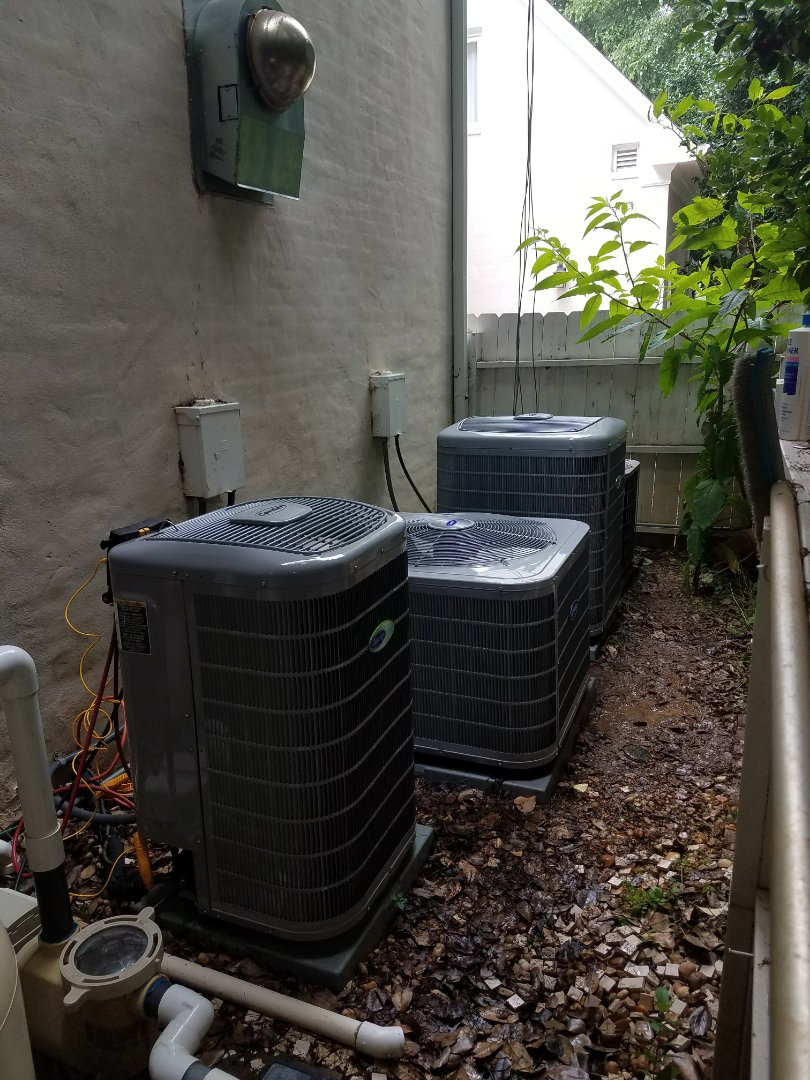 Sandy Springs, GA - Annual cooling service on 4 Carrier air conditioners.
