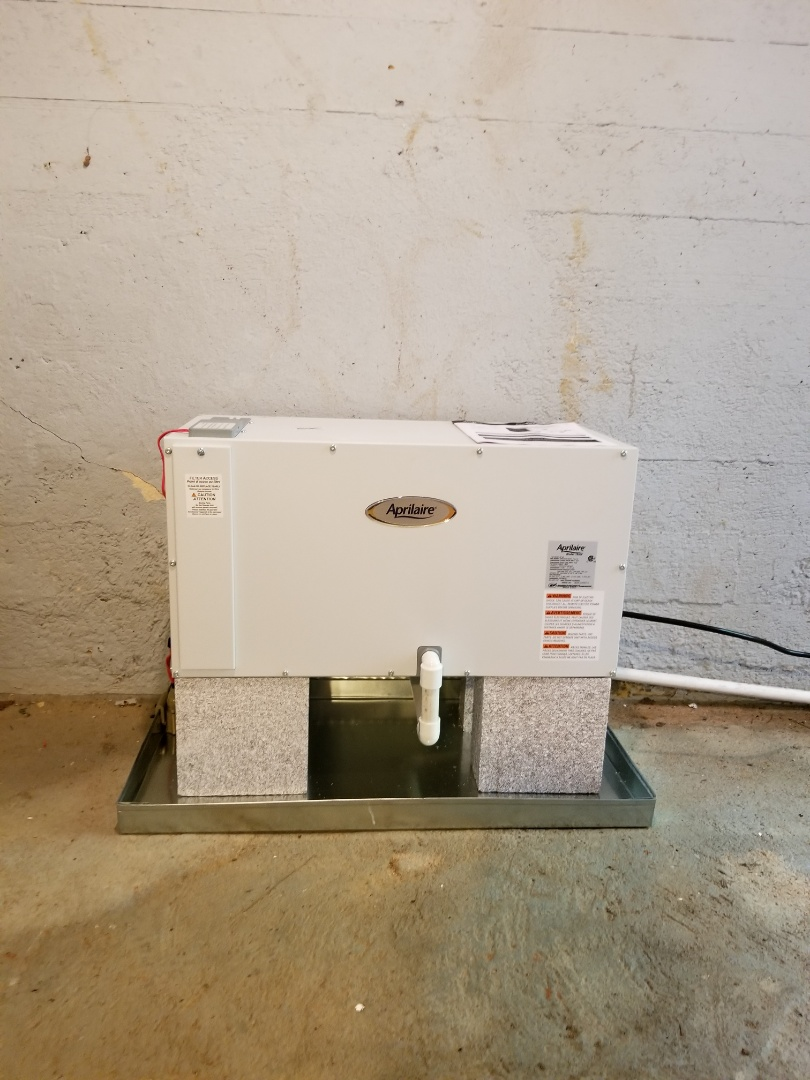 Sandy Springs, GA - Installing Aprilaire Wholehouse Dehumidifier to treat and remove humidity in entire home