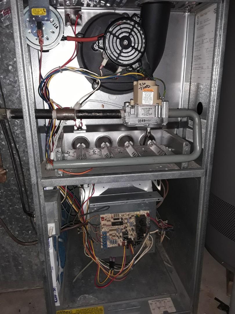 Smyrna, GA - Heat maintenance on Rheem furnace, replaced worn ignitor.