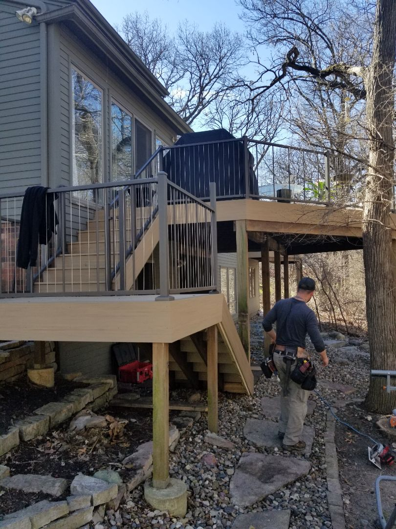 West Des Moines, IA - Finishing up Timbertech PVC deck with Westbury Verticable railing in West Des Moines, Iowa