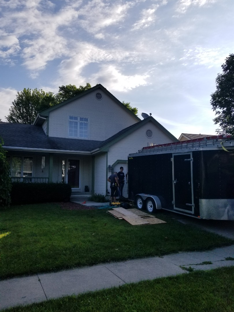 West Des Moines, IA - Getting started on vinyl siding install in West Des Moines