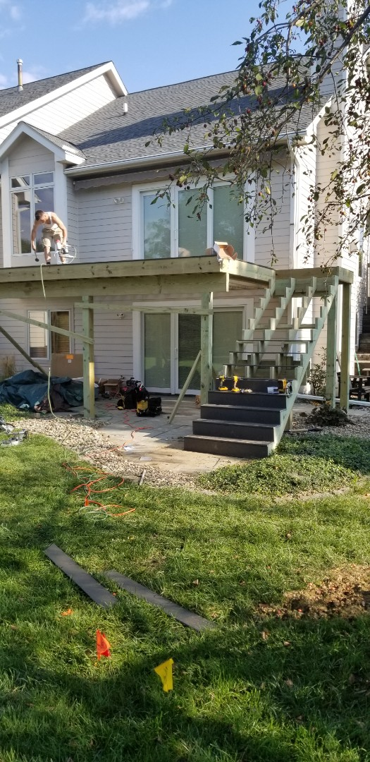 Johnston, IA - Starting to install this timbertech decking over in johnston
