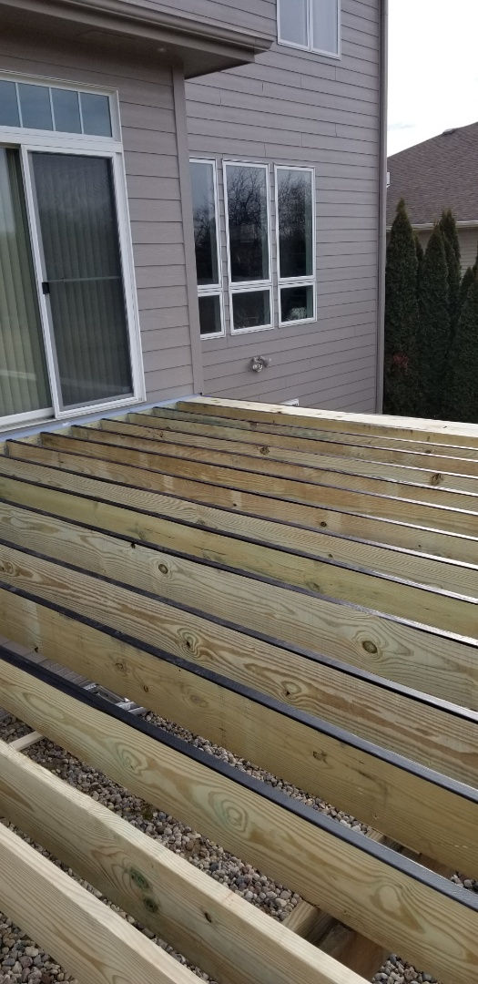 Johnston, IA - Finished frame and joist tape build stairs and start installing timbertech decking