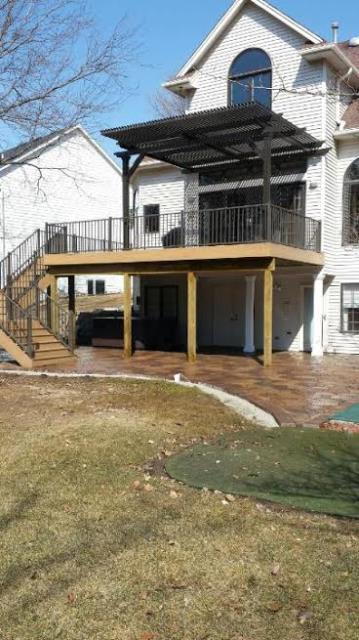 Urbandale, IA - Putting the finishing touches on this outdoor living project today! This Timbertech Deck and Louvered Roof look great with the Belgard Patio below! Finished just in time for Spring!!