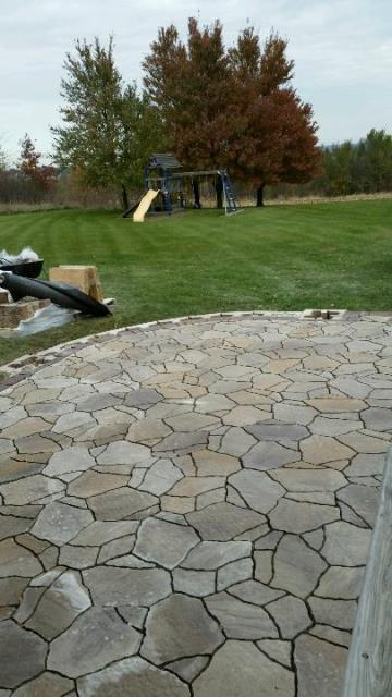 Carlisle, IA - This customer wanted to create an outdoor space for the entire family to enjoy! Belgard Mega-Arbel Patio, the seating wall and fire-pit area is next....