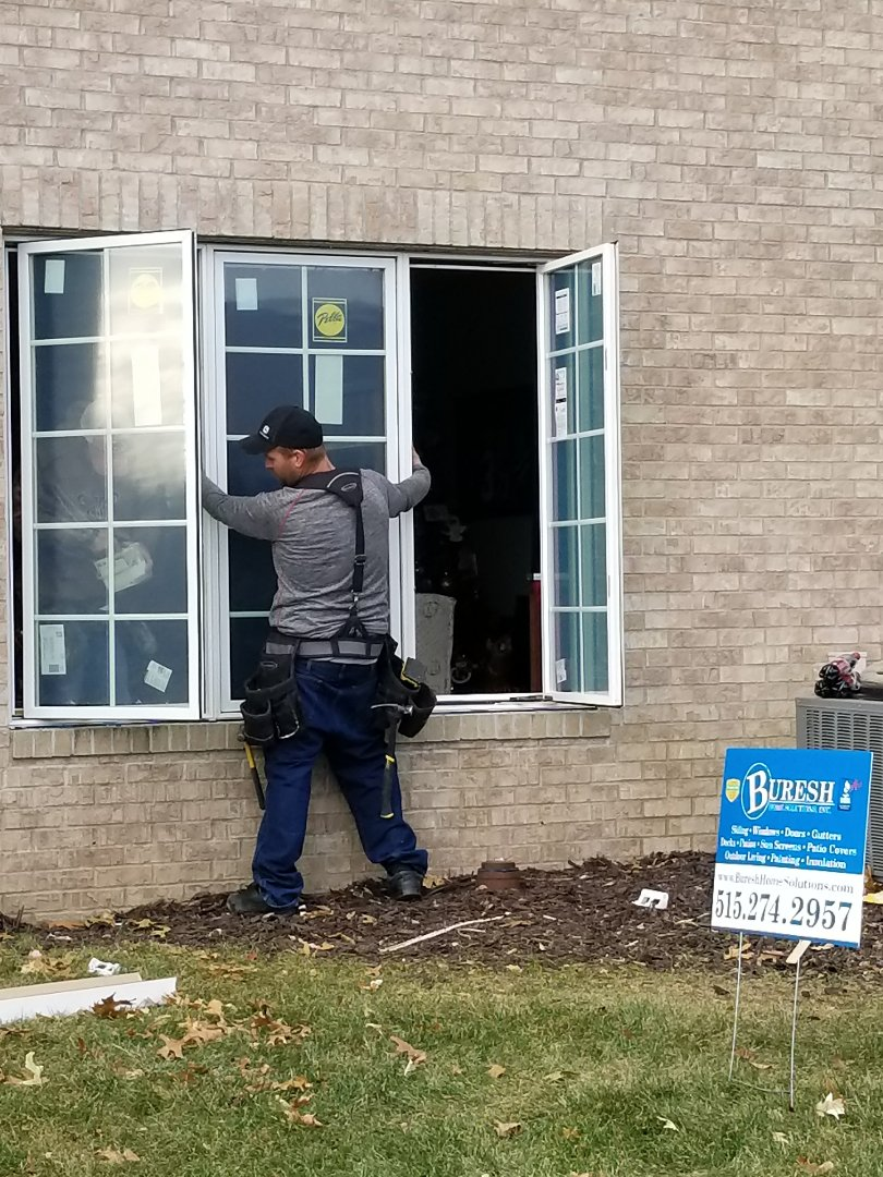 Clive, IA - Installing Pella replacement windows in Clive