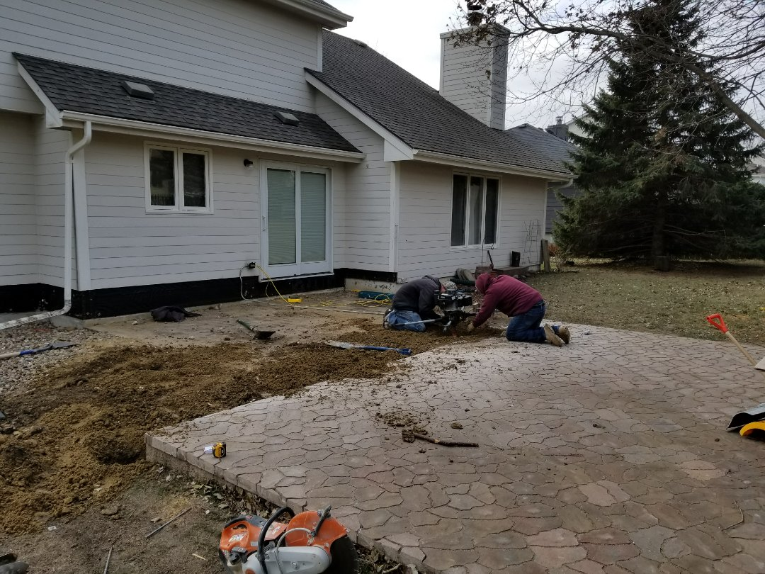 Urbandale, IA - Digging footings for deck replacement with Timbertech decking in Urbandale