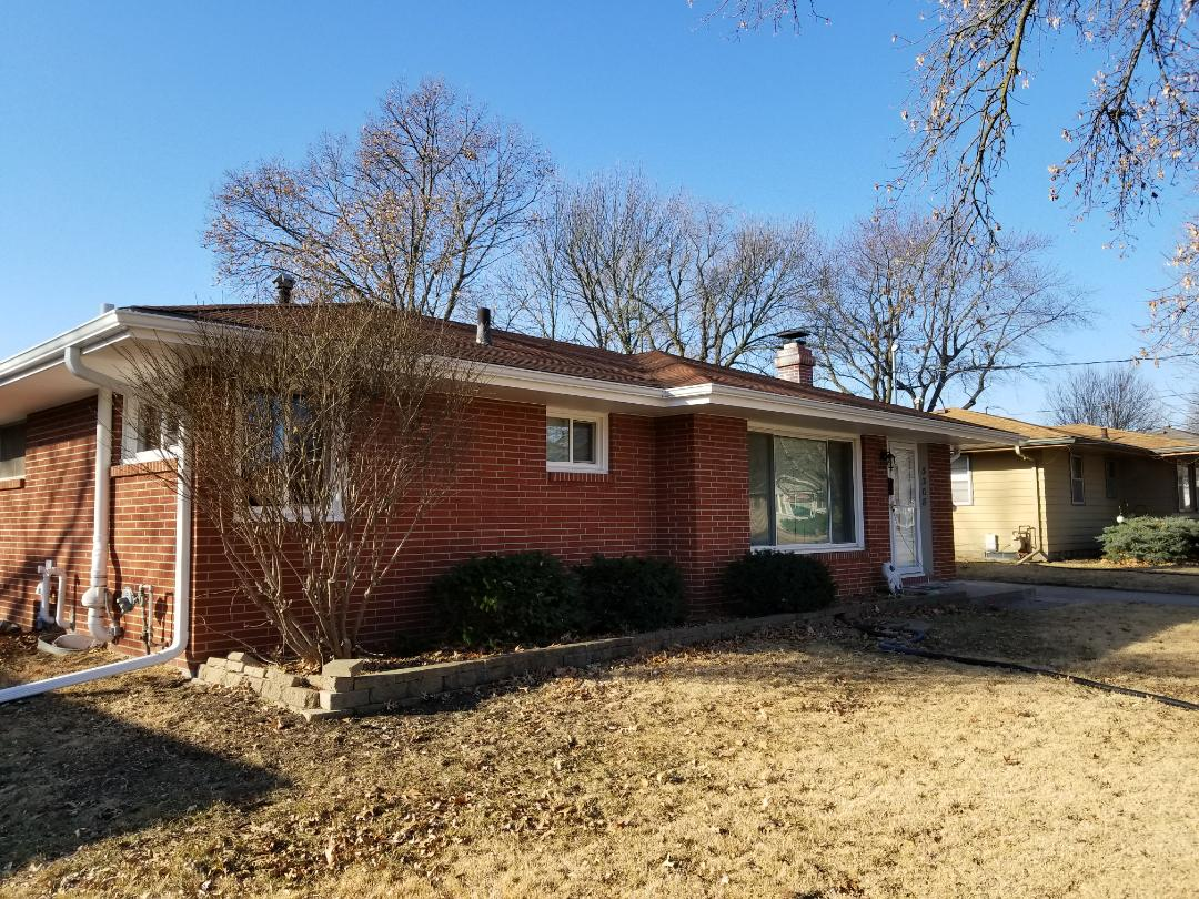 Des Moines, IA - Completed window replacement and new gutters and gutter protection in Des Moines