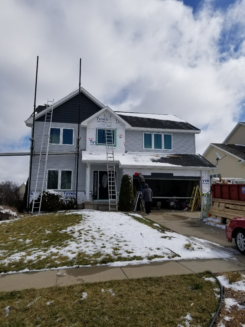 West Des Moines, IA - Getting close to completing Pella windows, entry door and patio door and vinyl siding installation