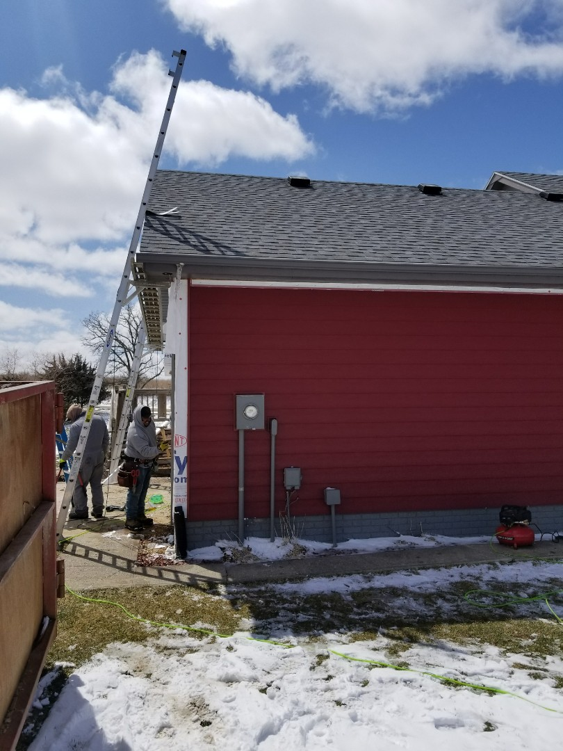 Earlham, IA - Everlast siding replacement moving along nicely in Earlam
