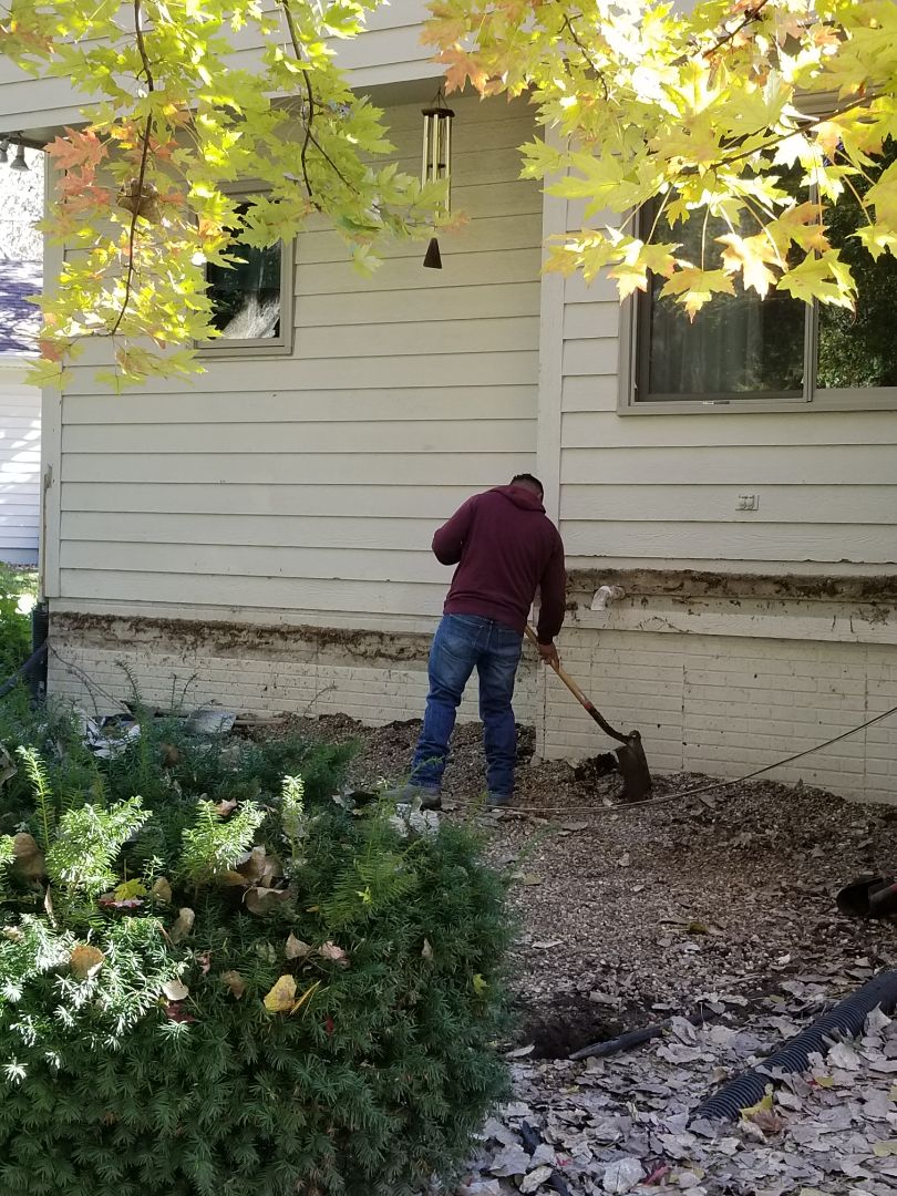 Clive, IA - Digging footings for new Timbertech decking installation