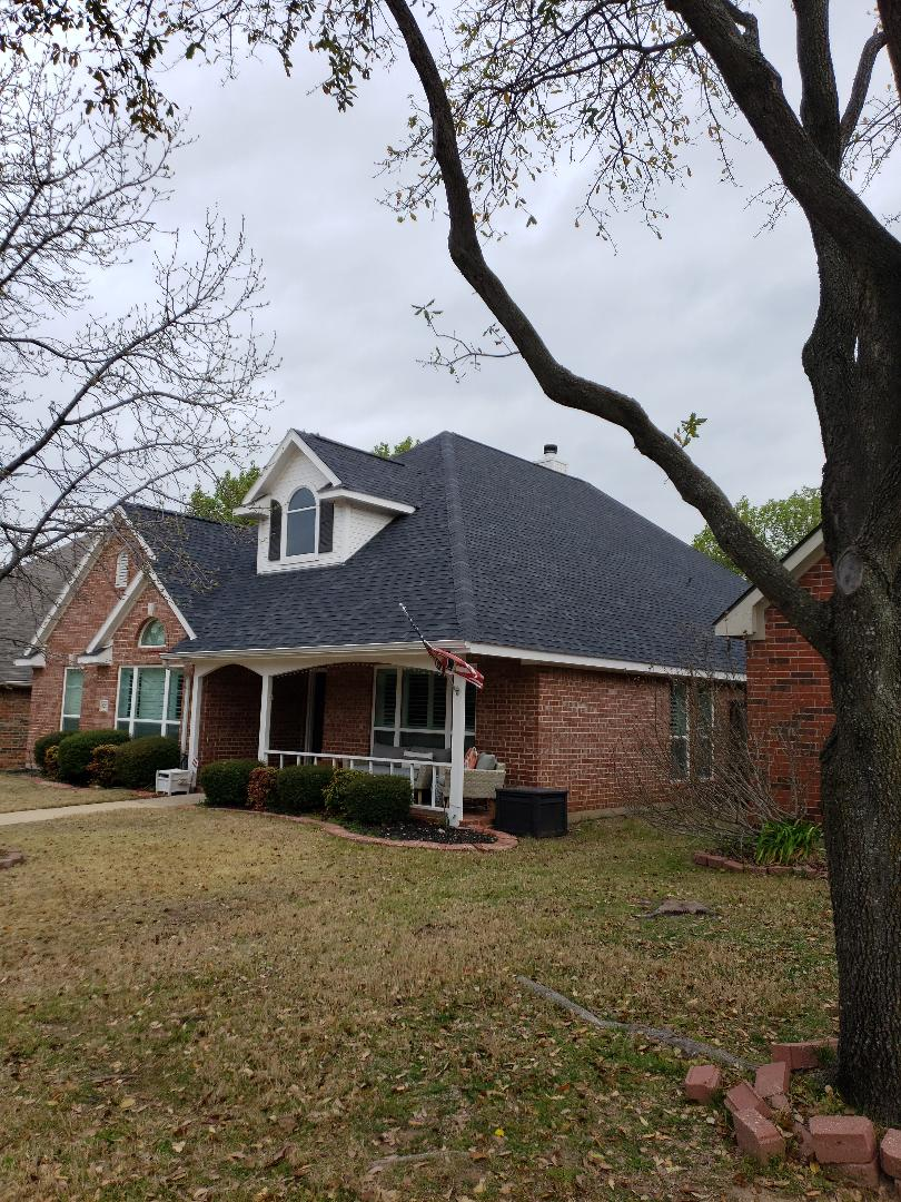 Plano, TX - Replaced our customer's roof with Owens Corning shingles, synthetic felt, and replaced their old vents with more efficient ridge venting.