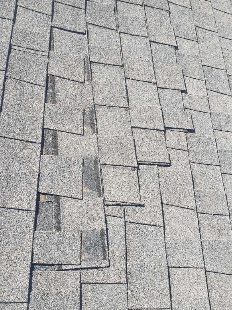 Frisco, TX - Shingles slipping and blown away from strong winds in Frisco. Weathered wood. Laminated composition shingles. Gaf. Owen's Corning. Roof repairs, replacement , installation.