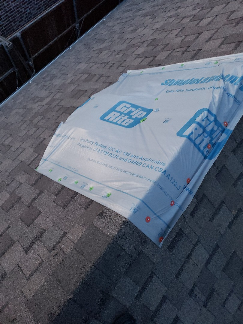 Frisco, TX - Doing no charge repairs and keeping our customer dry until we replace their roof with GAF 30 year shingle, synthetic felt and ridge vent.