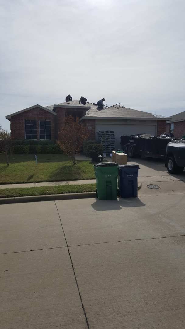 McKinney, TX - Removing the damaged shingles.