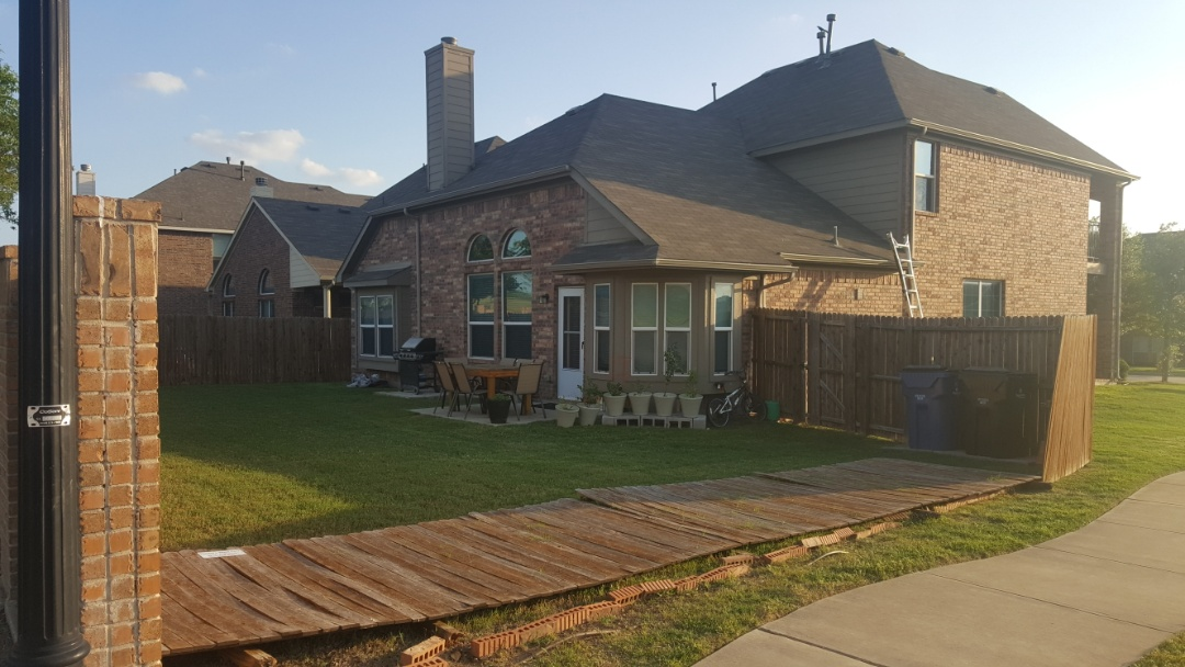 Frisco, TX - Another home receiving a facelift. Fence,  roof , gutters , and garage damage . New view is here to help.