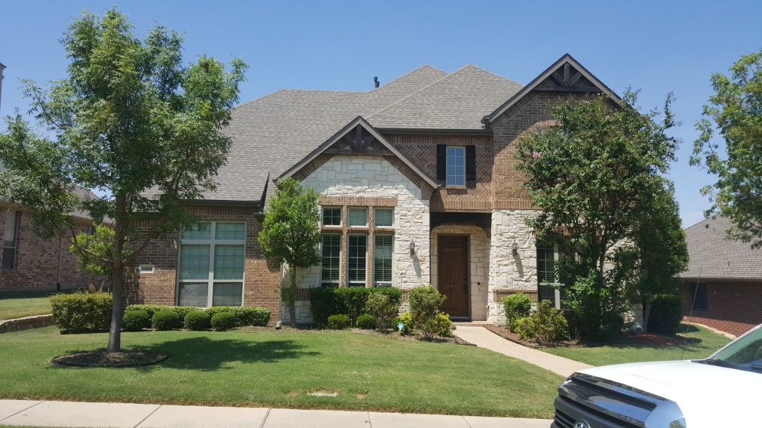 Allen, TX - Another roof replaced with GAF weathered wood shingles.   Such a beautiful day to work in Allen Texas.