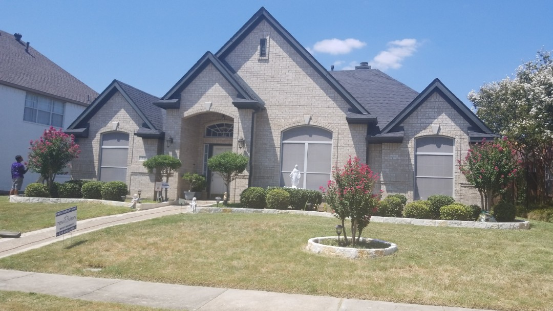 Carrollton, TX - Complete roof replacement. Installed Landmark weather wood 30 year shingle