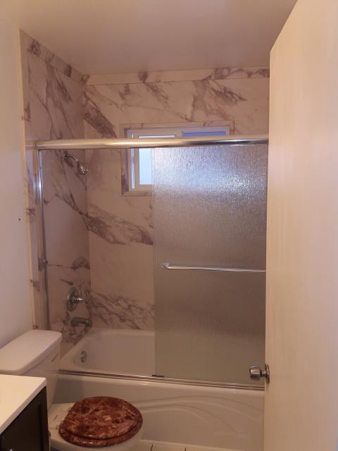 San Jose, CA - Tub and wall replacement. New Acrylic white tub and White Carrera granite panels. Quick turn around