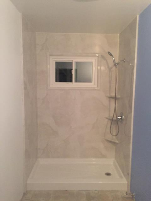 Walnut Creek, CA - Tub to walk in shower conversion. BCI Acrylic while shower base and Silver-white Marble smooth walls. Gorgeous.