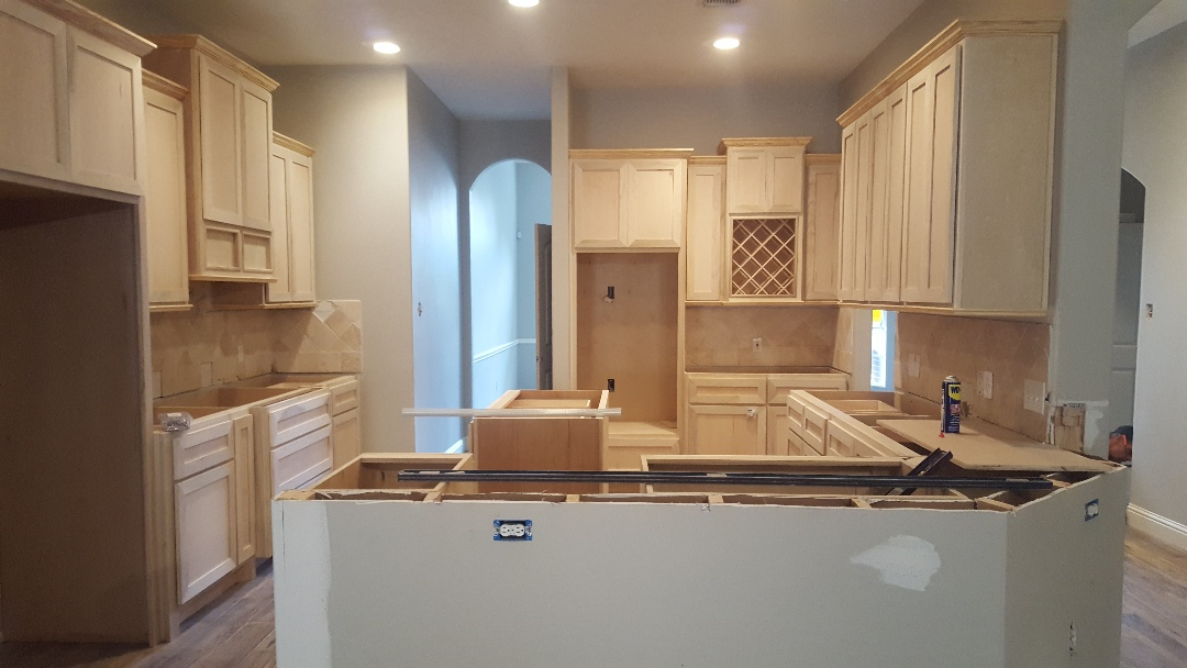 Houston, TX - Putting the finishing touches in the kitchen, the custom cabinets are coming together really nice.