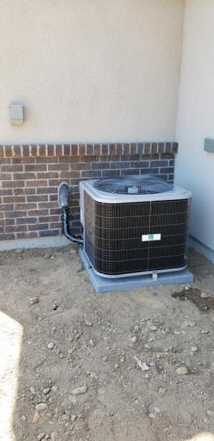 Morgan Hill, CA - Installing an AC cooling unit for a new residential home in Gilroy.