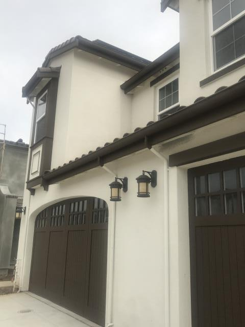 Morgan Hill, CA - Installing custom gutters and downspouts on a residential duplex in Morgan Hill.