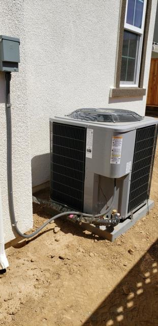 Morgan Hill, CA - Installing an air conditioning unit on a residential home in Morgan Hill.