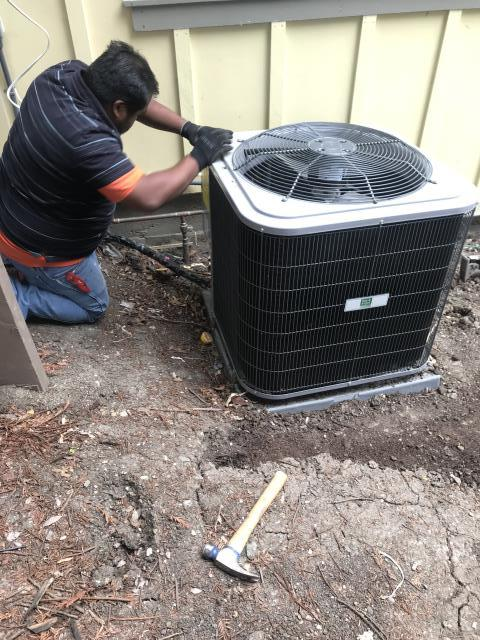Los Altos Hills, CA - Finishing the installation of a heating and ac system with a high efficient gas furnace and condenser on a remodeled home in Los Altos Hills.
