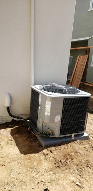 Morgan Hill, CA - Installing a high efficient heating and ac unit on a new home in Morgan Hill.