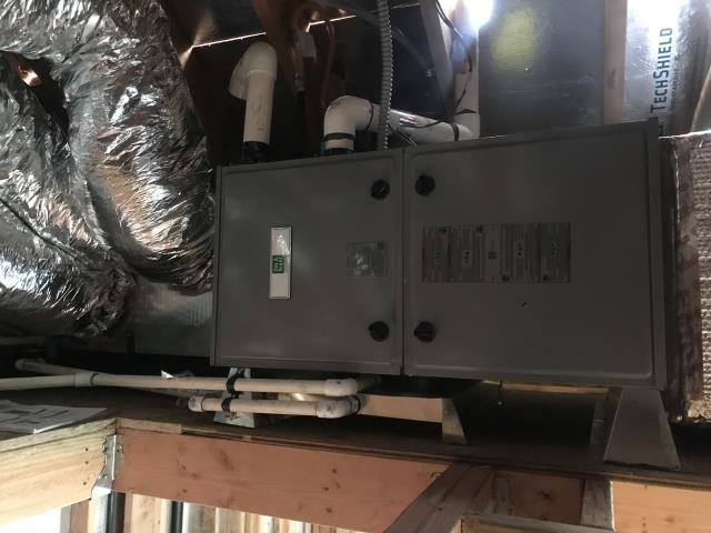 Los Altos Hills, CA - Installing a high efficient heating and ac system with an air purifier for upgraded indoor air quality on a new construction home in Los Altos.