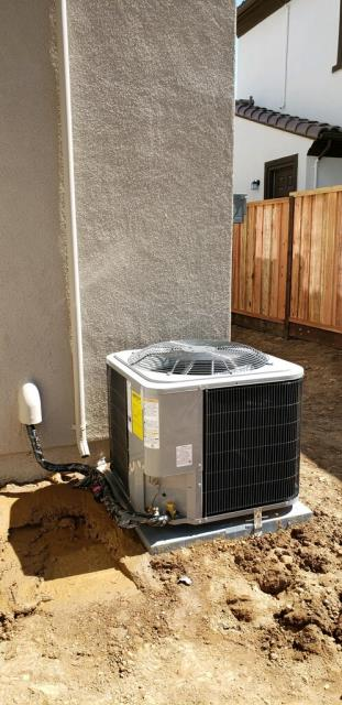 Morgan Hill, CA - Installing a high efficient air conditioning unit on a new residential home in Morgan Hill.