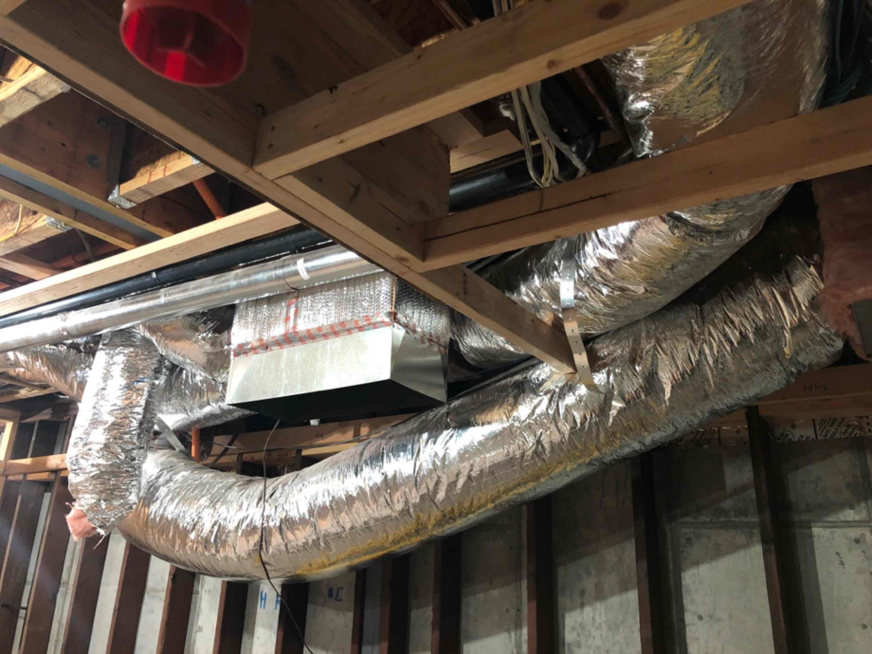 Los Altos, CA - Installing a new heating and air conditioning system on a new construction home in Los Altos.