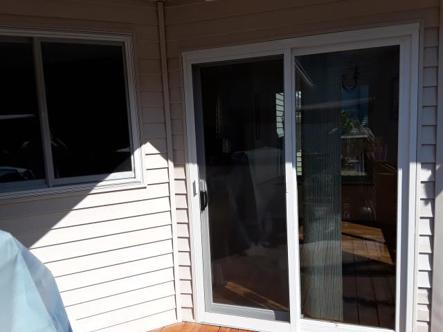 Marysville, WA - Renewal by Andersen installed this two-panel white Permashield Gliding Patio Door in this 1930's home.