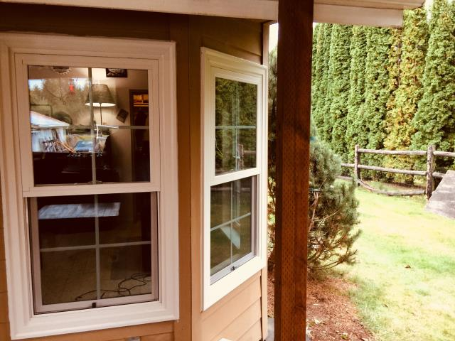 Snohomish, WA - Three Double Hung Windows with Colonial Grills replaced on this 2001 home to update failed vinyl windows.