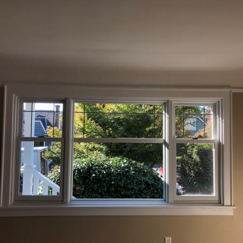 Seattle, WA - One large living room window converted into three with two Double Hung and one fixed Picture Window with modified prairie sashes maintaining the look of this 95 year old Ravenna home.