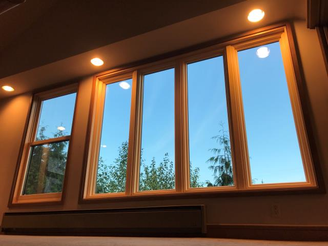 Seattle, WA - This Seattle home built in 1980 had it's original wood windows with clear signs of rot that tends to happen in our wet Northwest Climate. Our team came in and replaced them with durable Fibrex picture windows made from reclaimed wood fiber blended with polymer.