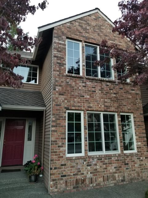 Kenmore, WA - This home in Kenmore had older vinyl windows with popped seals, fogging and condensation. The new energy efficient window included grilles whcih nicely complemented this brick home.