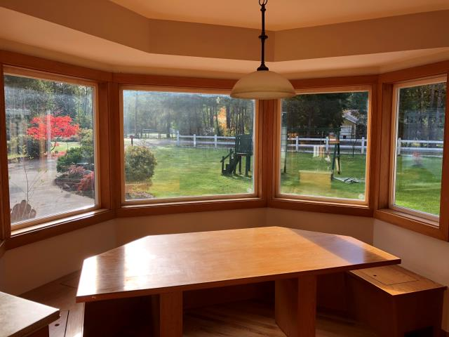Graham, WA - A home in Graham, WA that had their vinyl windows replaced. Existing windows faced mold, warping and sagging.