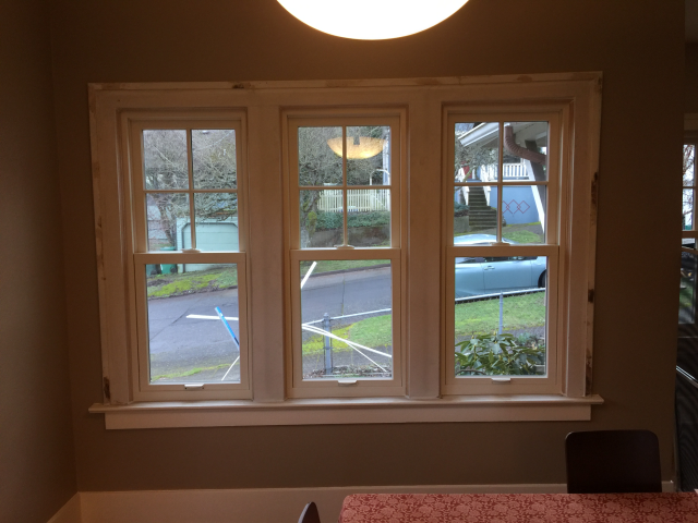 Seattle, WA - These custom windows with white frames kept the charming character of this 1920's homes while improving it's energy efficiency.